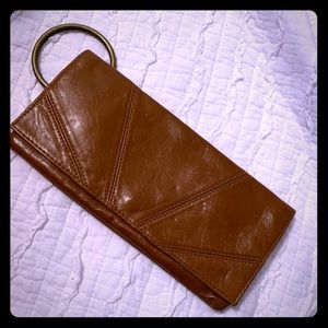 Round medal faux leather wristlet